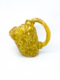 Danos Keramik kande i gul i en skøn form med et kraftigt håndtag